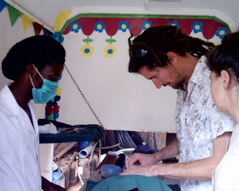 A kind vet operating in a mobile clinic